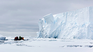 Boat approaching iceberg, ice floe in the southern ocean, 180 miles north of East Antarctica, Antarctica