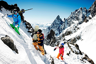 Group of skiers climbing steep mountain