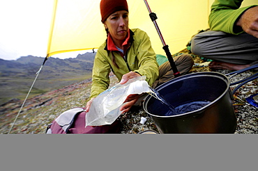 Hiker preparing food