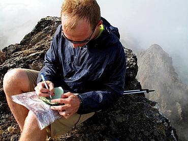 Hiker writing notes