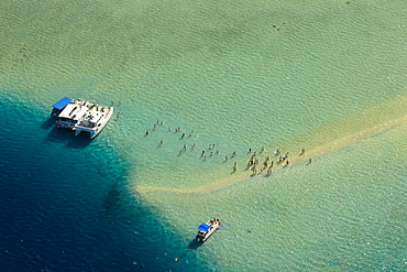 People enjoying the shallow waters of the sandbar in Kaneohe Bay, Oahu, Hawaii, USA.