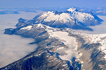 Coastal Range mountains surrounded by clouds, Vancouver to Chilko Lake, British Columbia, Canada.