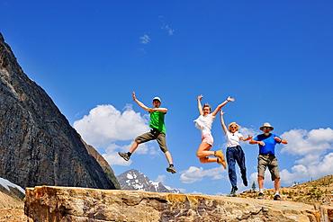 Tourists frolicking below Mt. Edith Cavell, Jasper National Park, Alberta, Canada.