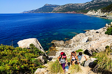 walkers, Es Cavall, Banyalbufar, Natural Park of the Sierra de Tramuntana. Mallorca. Balearic Islands. Spain.