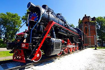 Ancient railway locomotive in Slyudyanka railway station, near Baikal lake, Siberia, Russia.
