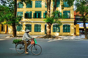 riding a bicycle in Hanoi, Vietnam.
