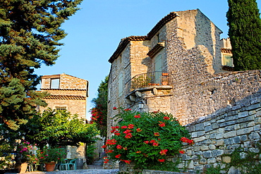 Typical street in Roque-sur-Ceze, labelled The Most Beautiful Villages of France. Gard deparment, Languedoc-Roussillon region. France.