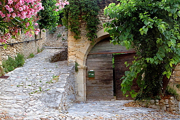 Typical paved street in Roque-sur-Ceze, labelled The Most Beautiful Villages of France. Gard deparment, Languedoc-Roussillon region. France.