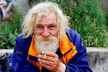A happy homeless in Prague.