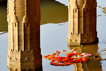 India, Uttar Pradesh, Varanasi, Sunken temple, Marygold garland.