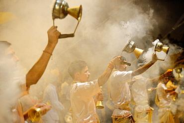 India, Uttar Pradesh, Varanasi, Offering of incense to the Ganges.