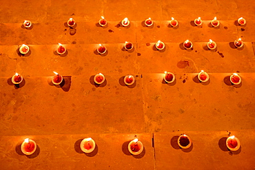 India, Uttar Pradesh, Varanasi, Dev Deepawali festival, Earthen lamps lit on the stairs leading to the Ganges.