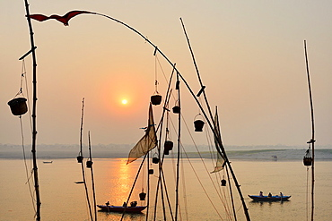 India, Uttar Pradesh, Varanasi, Sunrise on the Ganges.