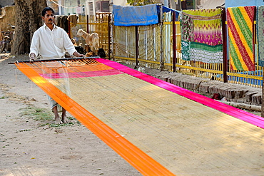 India, Uttar Pradesh, Varanasi, Silk worker.