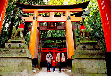 A family walking together at Fushimi Inari Kyoto Japan