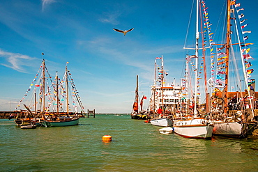 Various vessels in the harbour at Yarmouth, Isle of Wight, England during the Old Gaffers Festival.