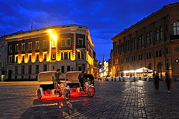 pedicab on Dome Square by night, Old Town, Riga, Latvia, Baltic region, Northern Europe
