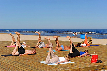 stretching class on a beach of Jurmala, Gulf of Riga, Latvia, Baltic region, Northern Europe.