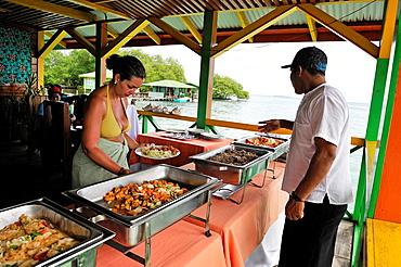 restaurant on stilts at Cayo Coral, southern headland of Bastimentos Island, Bocas del Toro Archipelago, Republic of Panama, Central America