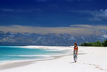 young woman on a beach of Bird Island, Republic of Seychelles, Indian Ocean