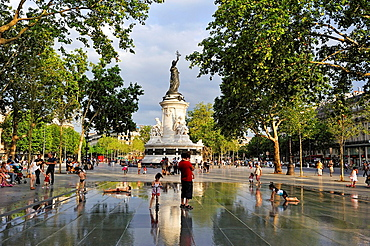 ornamental pond with in background the statue of Marianne on the monument devoted to the newly-proclaimed Third Republic, designed by the Morice brothers in 1880, Place de la Republique, Paris, Ile de France region, France, Europe.