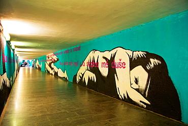 Graffiti art work in corridor connecting Holesovice railway station and metro station Prague city Bohemia region Czech Republic Europe.