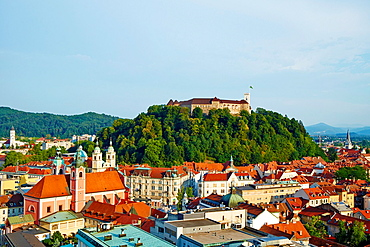 Slovenia, Ljubljana, cityscape with Franciscan church, Saint Nicholas church and the Castle.