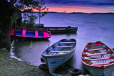 Moored boats at sunset on Lough Owel, near Mullingar, County Westmeath, Ireland.