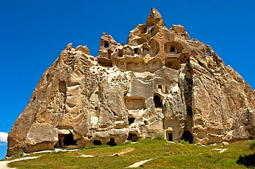 Hollowed fortress-like tuff rocks with storage rooms at the UNESCO World Heritage site Ga∂reme National Park and the Rock Sites of Cappadocia, Cavusin, Cappadocia, Turkey.