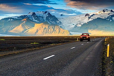 4WD vehicle crossing a mountain landscape in south Iceland, Europe.