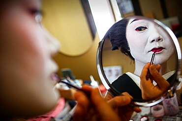 Toshiyu applying makeup in her Okiya (geisha house).Geisha from geisha's distric of Miyagawacho.Kyoto. Kansai, Japan.