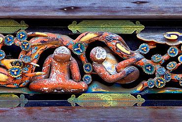 sculptures next to the sculptures of the three wise monkeys. Tosho-gu shrine. Nikko. Japan.