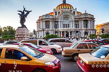 Traffic and Palacio de Bellas Artes, Mexico City, Mexico.