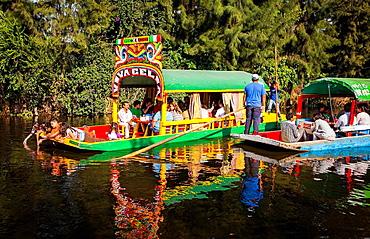 Trajineras on Canal, Xochimilco, Mexico City, Mexico.