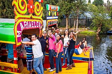Friends, Trajineras on Canal, Xochimilco, Mexico City, Mexico.