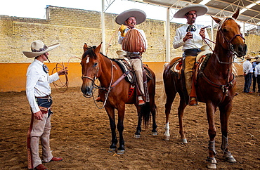 Mexican charros. A charreada Mexican rodeo at the Lienzo Charro Zermeno, Guadalajara, Jalisco, Mexico.
