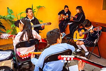 Guitar class in Courtyard of Casa Museo Jose Alfredo Jimenez,Guanajuato 13, Dolores Hidalgo, Guanajuato State, Mexico.