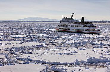 Frozen sea and sightseeing icebreaker, Aurora ship 2,Abashiri, Hokkaido,Japan.
