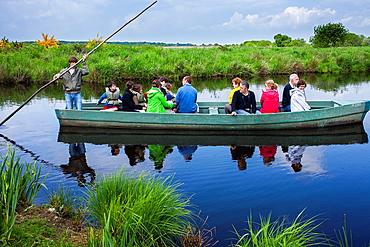 Barge with tourists,near Port of Breca, Natural regional park of La Briere, Loire Atlantique, Pays de Loire, France.