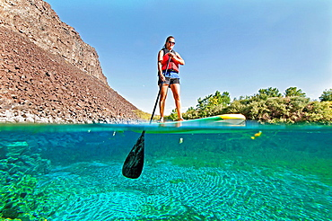 riding the Standup Paddle Board at Blue Heart Spring in the Snake River Canyon near the city of Hagerman in southern Idaho.