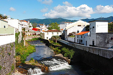 Gentle stream of water passing through the city of Ribeira Grande. Sao Miguel island, Azores, Portugal.
