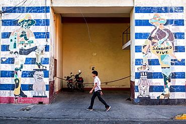 Walls painted with Sandino´s silhouette, Leon, Nicaragua.