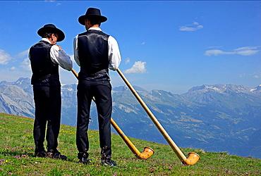 Two men with alphorns, Swiss Alps, Nendaz, canton Valais, canton Wallis, Switzerland