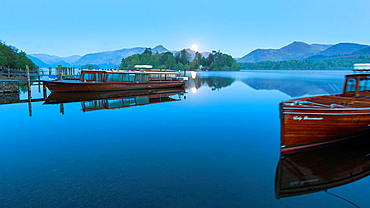 Boats on Derwent Water at sunrise, Keswick, Lake District National Park, Cumbria, England, UK, Europe.