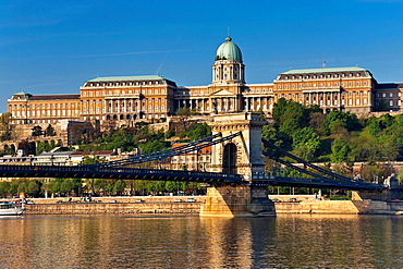 View over Danube river to Szechenyi Chain Bridge and Buda Castle on Castle Hill in the Castle District, Budapest, Hungary, Europe.