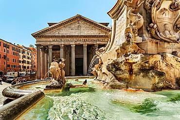 The Pantheon is an ancient building in Rome and since 609 ad, a Catholic Church. It is located on the Piazza della Rotonda. The fountain was created by the sculptor Giacomo della Porta in 1575, Rome, Lazio, Italy, Europe.