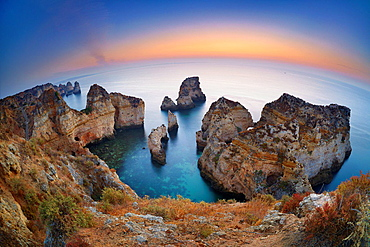 Landscape at Algarve coast before sunrise, Ponta da Piedade, Algarve, Lagos, Portugal.