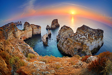 Sunrise at Algarve coast near Lagos, Algarve, Portugal.