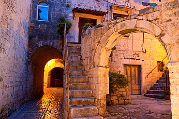 archway and house in old town of Trogir at night, Croatia.