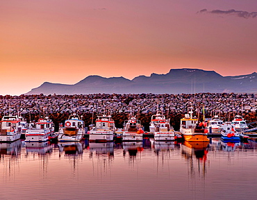 Boats in the harbor with the Midnight Sun, Olafsvik, Snaefellsnes Peninsula, Iceland.